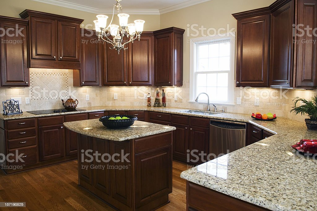Large kitchen with a center island and granite countertops stock photo