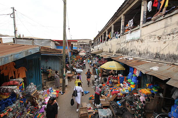 large kumasi central market, ghana, west africa - kente cloth stock photos and pictures