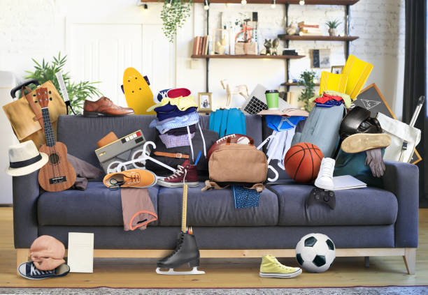 Large leather sofa with mess stock photo