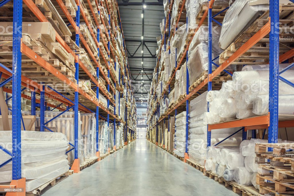 Large Logistics hangar warehouse with lots shelves or racks with pallets of goods. Industrial shipping and cargo delivery royalty-free stock photo