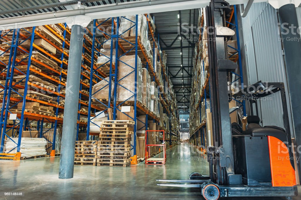 Large Logistics hangar warehouse with lots shelves or racks with pallets of goods. Industrial shipping and cargo delivery zbiór zdjęć royalty-free