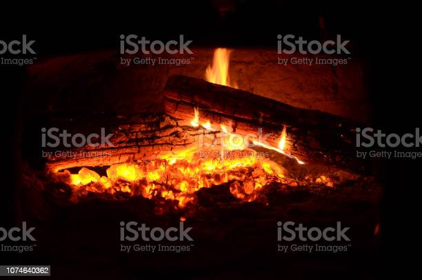 Photo of large logs burning in the oven