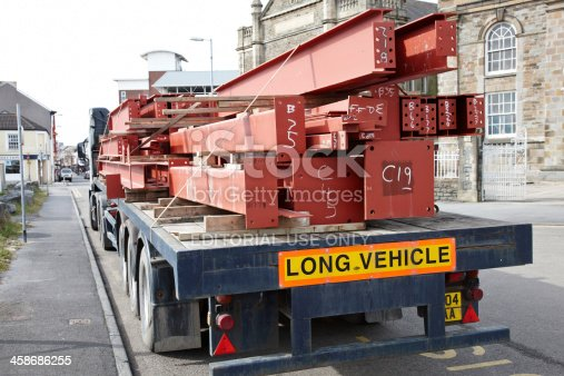 Llanelli, Wales - March 14, 2011: Large lorry delivering heavy steel girders to building site. Vehicle parked in Upper Park Street in the town of Llanelli