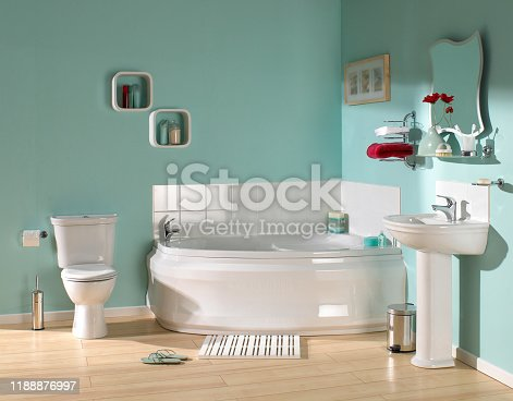 Interior of large luxurious bathroom in pastel green