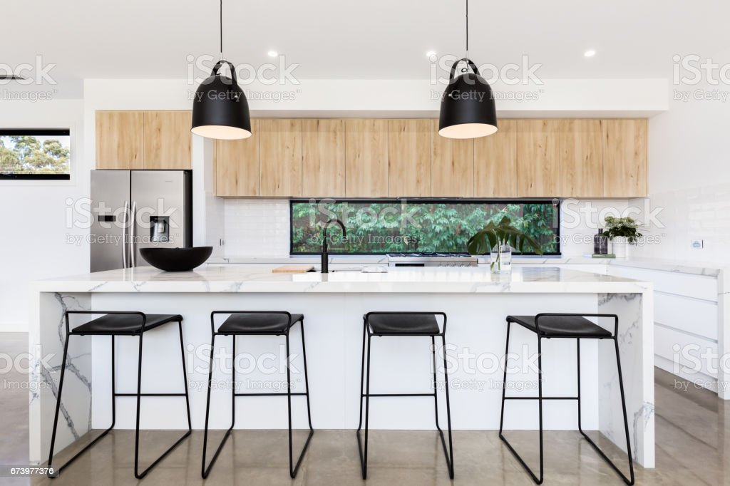 Large luxury Australian kitchen with marble island bench stock photo
