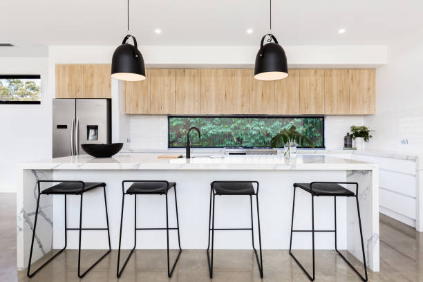 Large luxury Australian kitchen with marble island bench stock photo