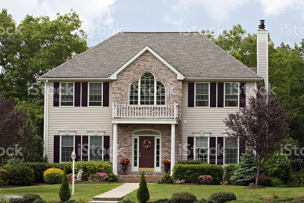 A large custom built luxury house in a residential neighborhood. This...