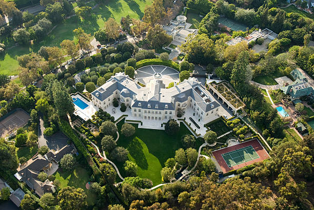 Large Mansion in Holmby Hills (Los Angeles), California Los Angeles, California, USA - October 13, 2007: Large mansion in the exclusive area of Holmby Hills in Los Angeles. The mansion was built in 1991 by the late TV producer Aaron Spelling. The house was placed on the market by his widow, Candy Spelling, in 2009 for $150 million. In 2011, the house was sold for $85 million to Petra Ecclestone, daughter of Formula One billionaire Bernie Ecclestone. westwood neighborhood los angeles stock pictures, royalty-free photos & images