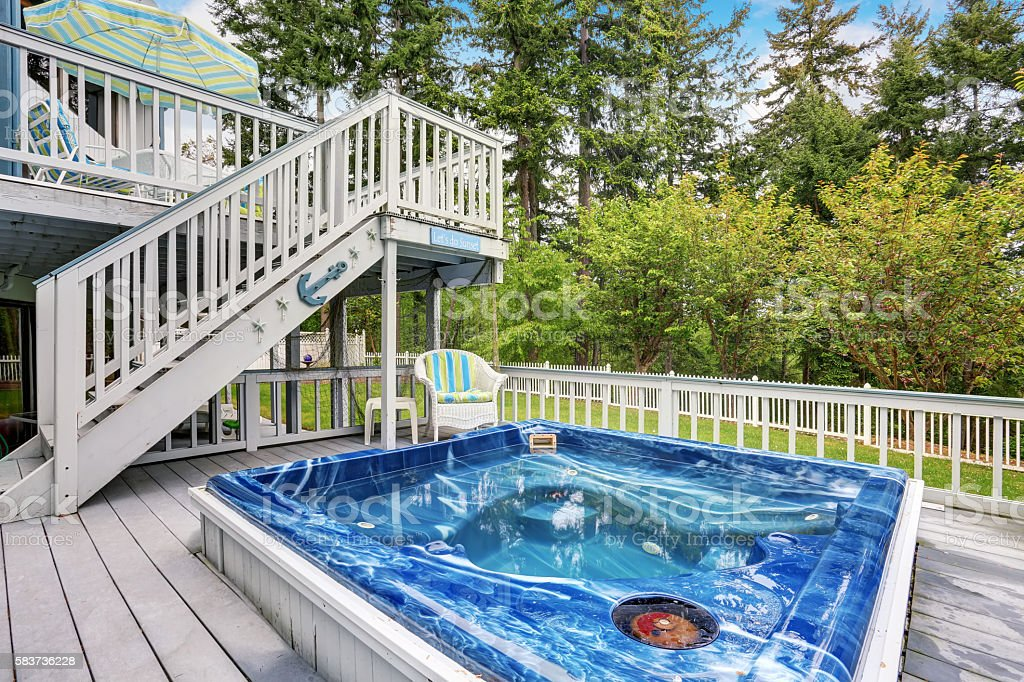Large marine style home with two level deck. Jacuzzi view stock photo