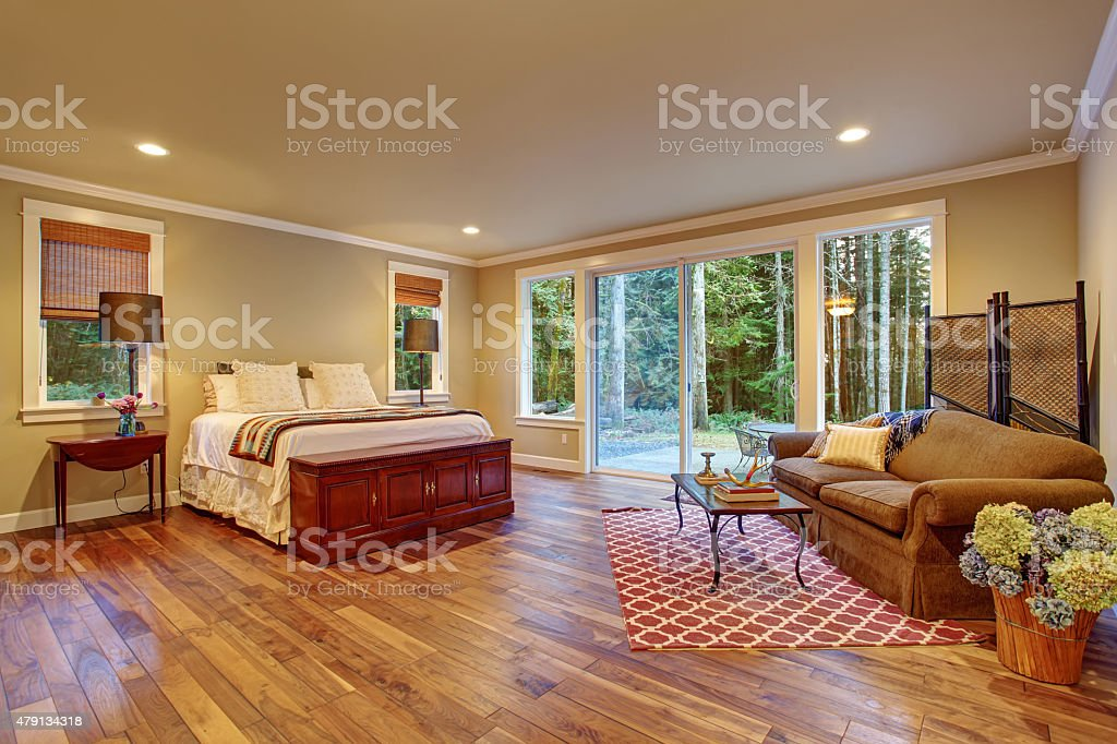 Large master bedroom wth hardwood floor. stock photo