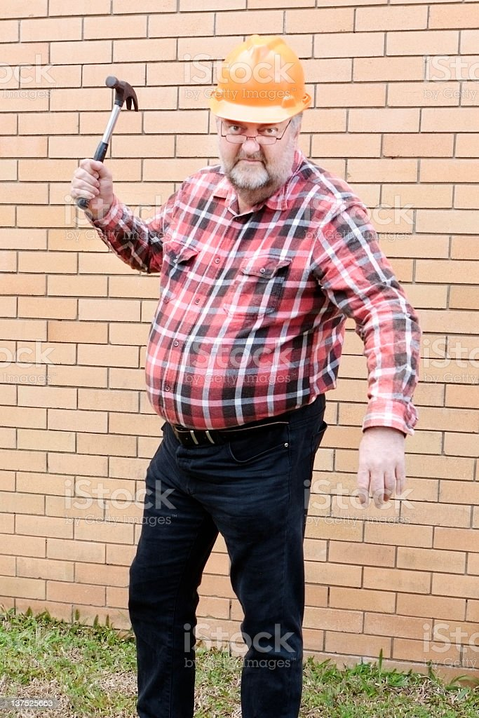 large mature man threatens with hammer royalty-free stock photo