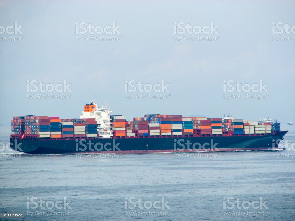 A Large Merchant Ship Container Vessel In Coastal Waters Of