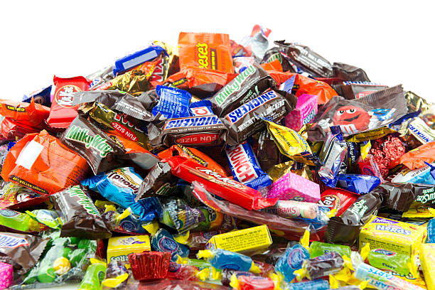 large messy pile of candy - kit kat stock photos and pictures