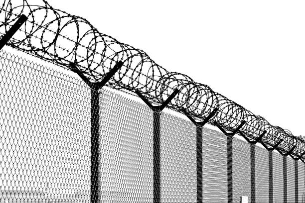 Large metal fence. Black and white. stock photo