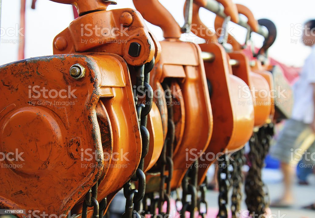 Large metal hook and chains attached to a pulley stock photo