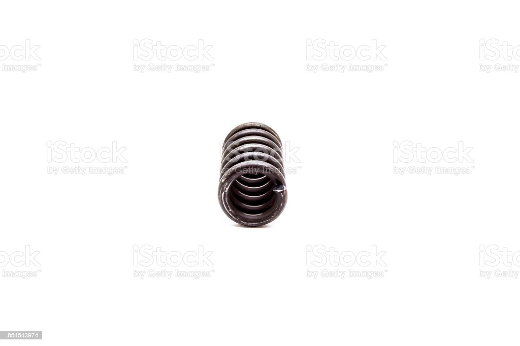 A large metal spring on white background stock photo