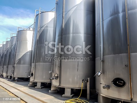 Large metal tanks for the production of wine, storage of liquids in large volumes are lined up