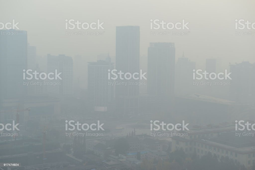 Large metropolitan city with terrible air pollution and smog, a contributor to health problems and potentially linked to global warming and climate change due in part to burning of fossil fuels stock photo