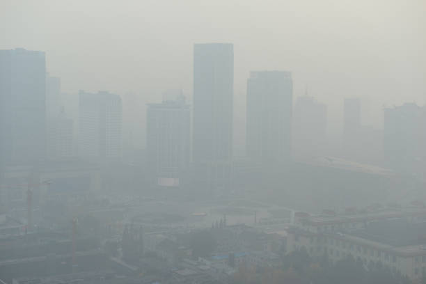 large metropolitan city with terrible air pollution and smog, a contributor to health problems and potentially linked to global warming and climate change due in part to burning of fossil fuels - contributor stock pictures, royalty-free photos & images