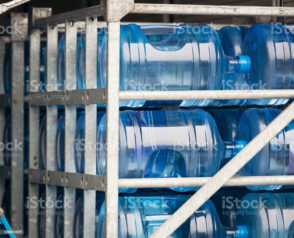 Large mineral water bottles stacked for delivery stock photo
