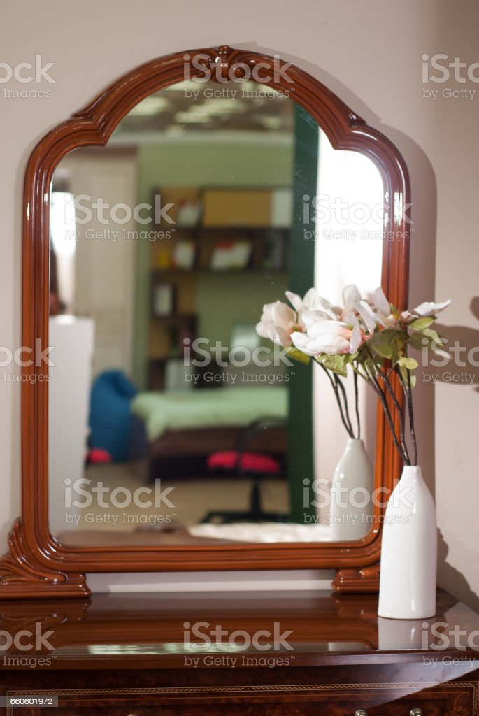 A large mirror in a wooden frame, royalty-free stock photo