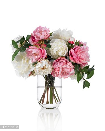 A pink peony bouquet in a tall glass vase. Shot against a bright white background. There is a path which may be used to delete the reflection if desired. Extremely high quality faux flowers.