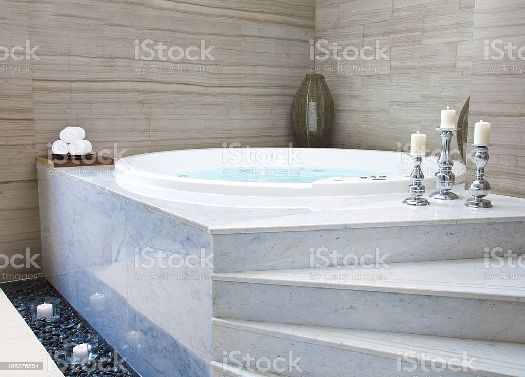 A Large Modern Jacuzzi Bathtub With Stairs Leading Up To It Stock ...