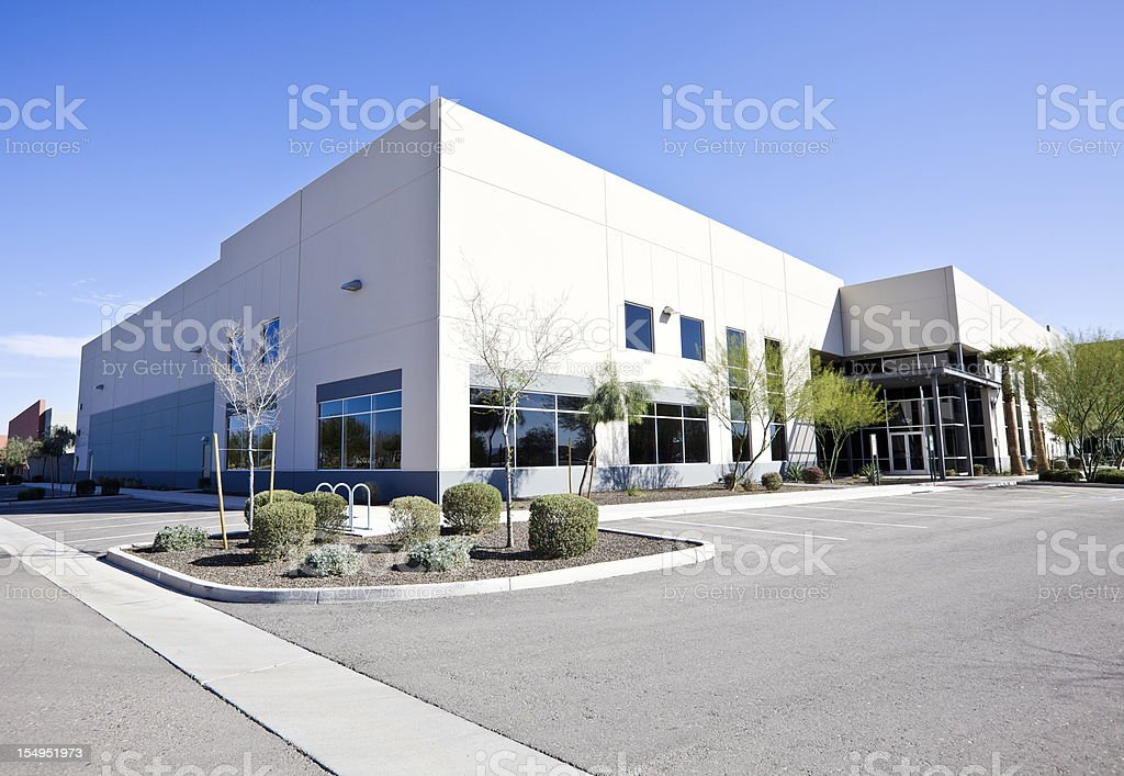 A large modern office building A office building against a blue sky. Architecture Stock Photo