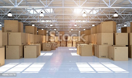 istock Large modern warehouse full of mechandise and cardboard boxes 495625576
