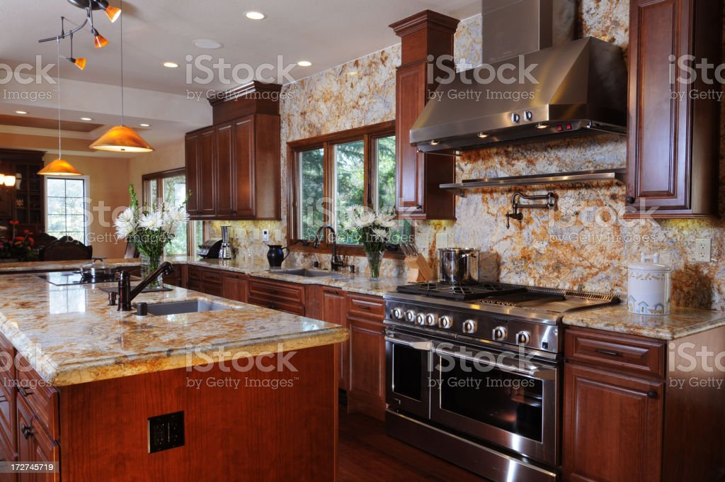 Large New Home Kitchen with Granite Counter Top royalty-free stock photo