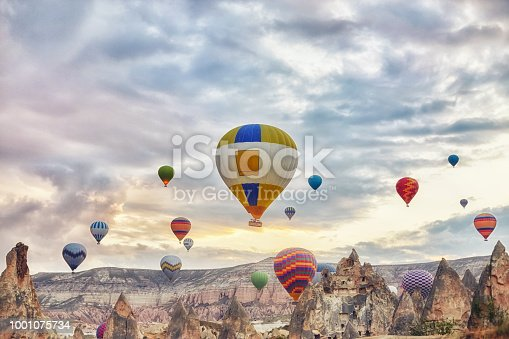 515376634 istock photo Large number of balloons fly in morning in the sky in rays of the dawn sun. Balloons balloons in the sky in the clouds above the mountains. Main attraction of Cappadocia, Turkey. Fabulous view 1001075734