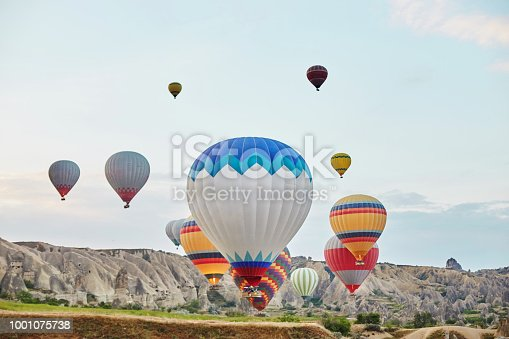 515376634 istock photo Large number of balloons fly in morning in the sky in rays of the dawn sun. Balloons balloons in the sky in the clouds above the mountains. Main attraction of Cappadocia, Turkey. Fabulous view 1001075738