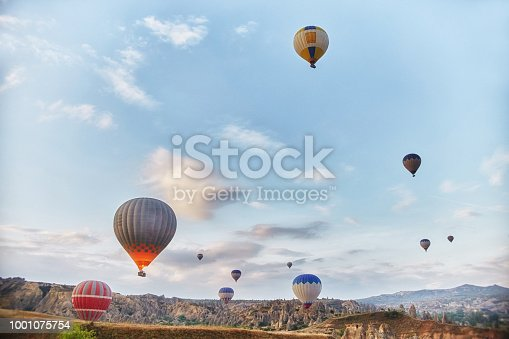 515376634 istock photo Large number of balloons fly in morning in the sky in rays of the dawn sun. Balloons balloons in the sky in the clouds above the mountains. Main attraction of Cappadocia, Turkey. Fabulous view 1001075754
