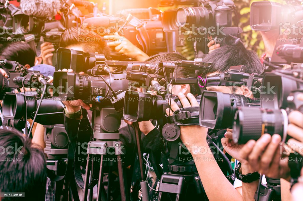 large number of press and media reporter in broadcasting event large number of press and media reporter in broadcasting event Board Room Stock Photo