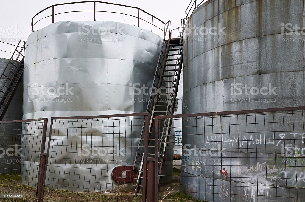 Large Oil Storage Tanks With Ladders And Safety Railing