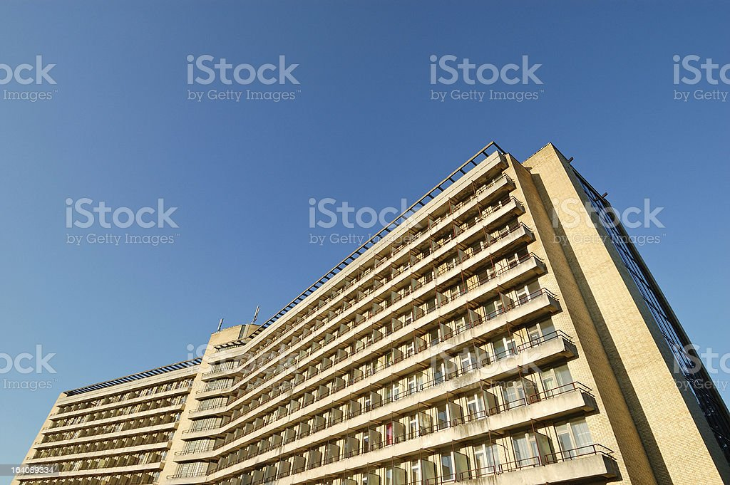 Large old abandoned hotel wide angle view clear blue sky royalty-free stock photo