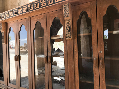 A large old antique antique wooden bookcase, documents in the Arab Islamic Mosque, a temple for prayers to God