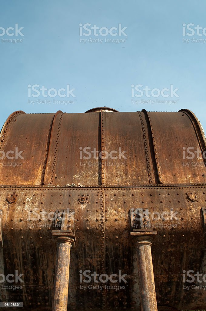 Large old rusted sugar mill storage tank royalty-free stock photo