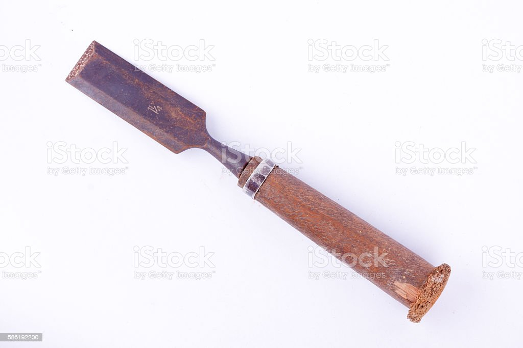 large old used flat chisel wood carving woodworking tools stock photo