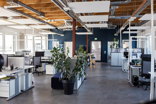 Interior of modern open plan office with no people. Interior of of a large place of work with coworking desks.