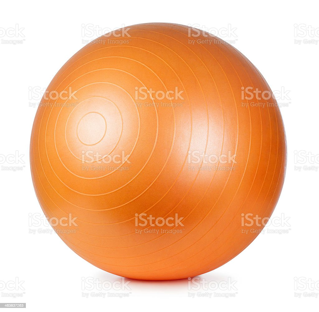 A large orange fitness ball on a white background stock photo