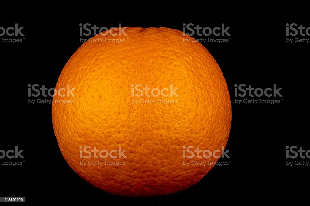 Large Orange on a Black Background stock photo