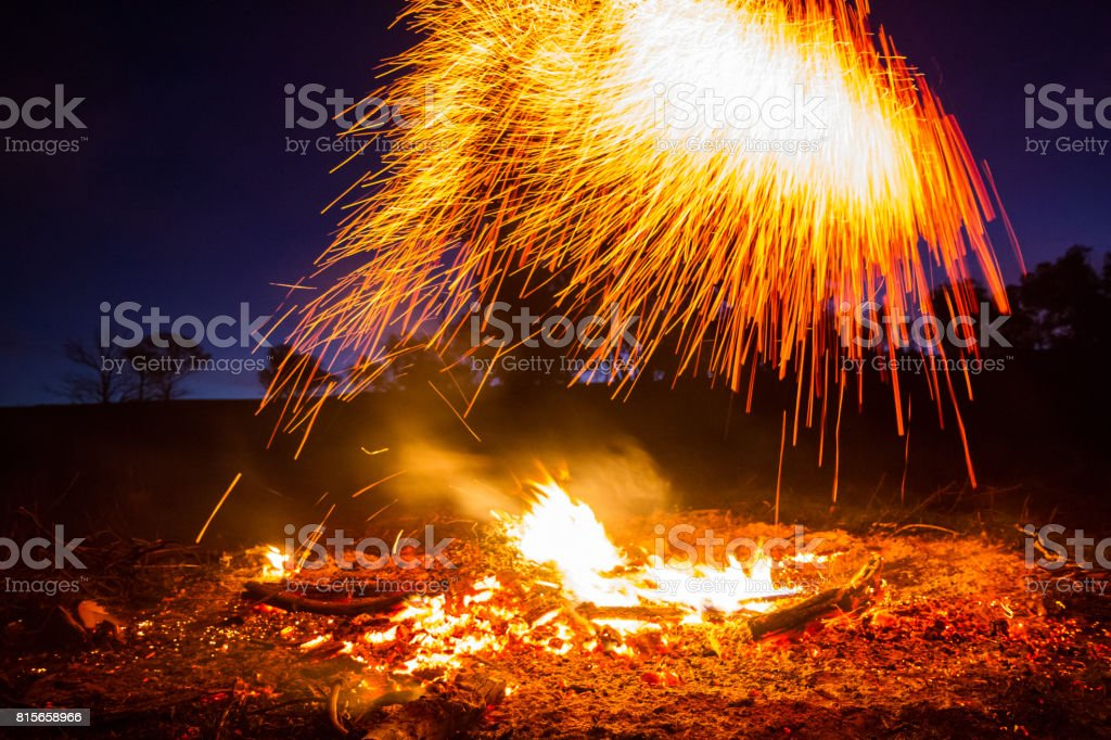 A slow shutter speed makes this fire appear distorted with the sparks...