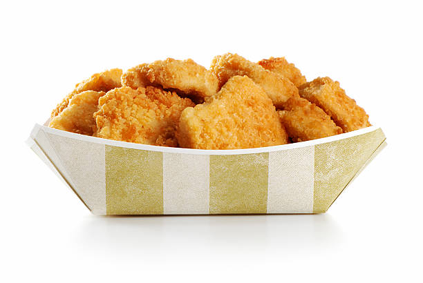 A large order of chicken nuggets in a paper tray stock photo