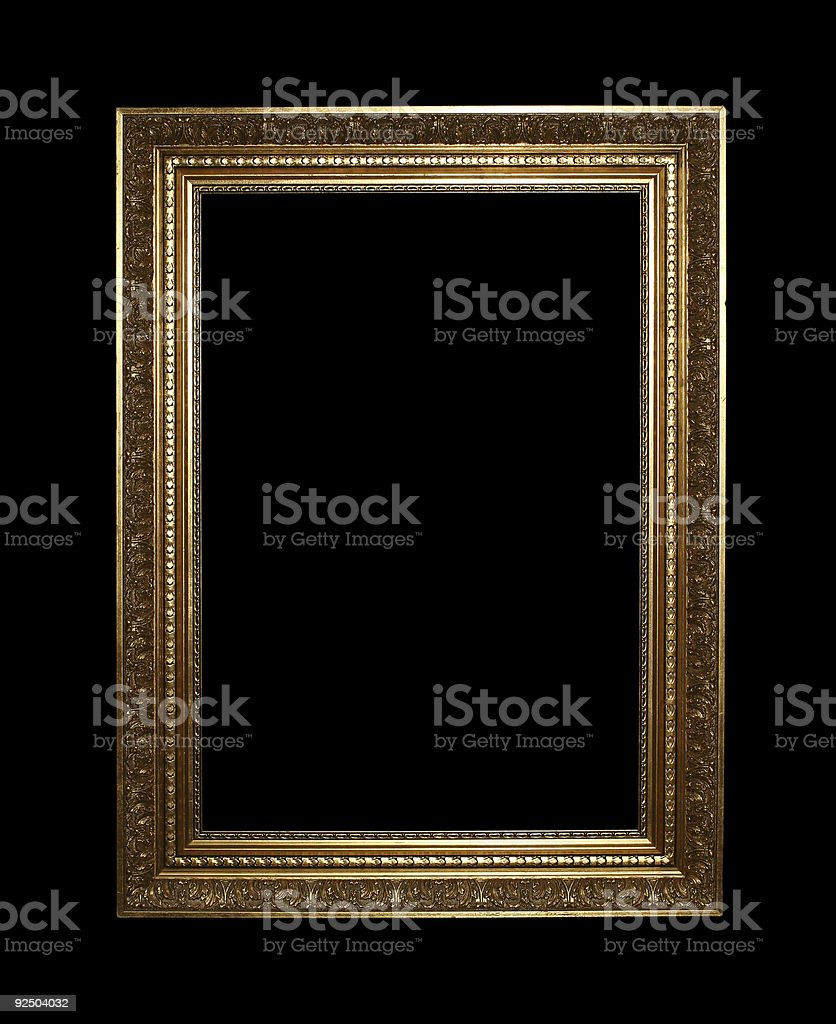 A large, ornate frame in gold on a black background royalty-free stock photo