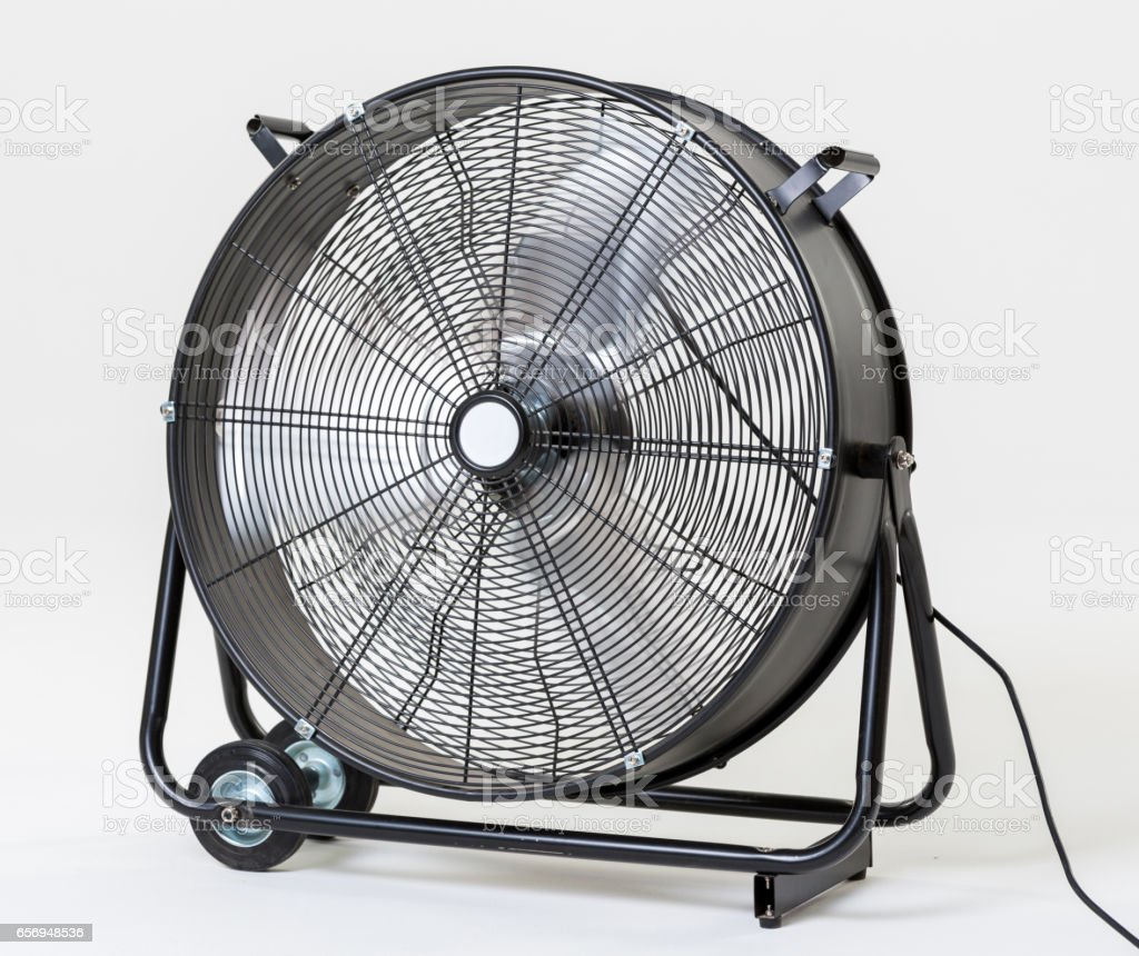 Large outdoor fan in black casing with wheels royalty free stock photo