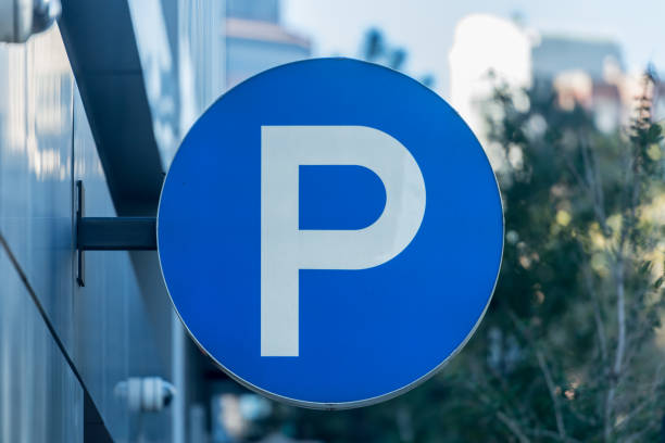 Large P Parking Sign Large P Parking Sign along city parking deck letter p stock pictures, royalty-free photos & images