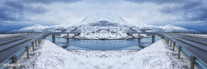 Large panorama with two symmetric roads between islands in winter, composite image, Lofoten Islands, Norway