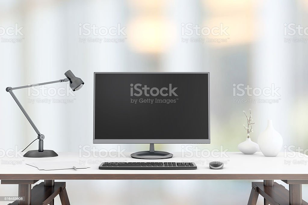 Large PC monitor on a business background stock photo