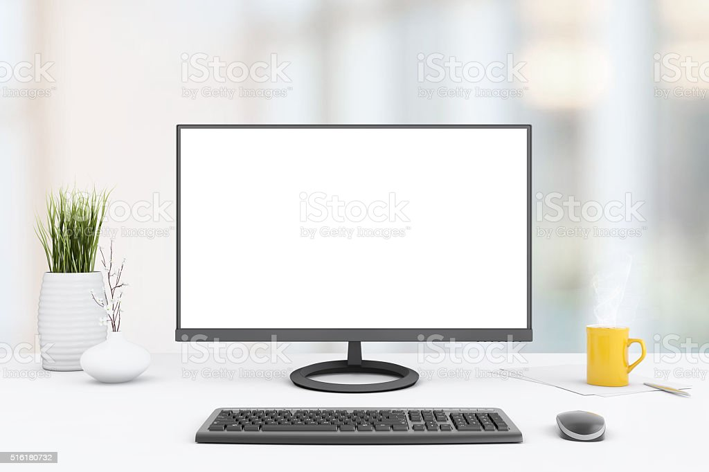 Large PC monitor on out of focus background stock photo